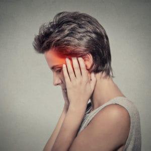 side profile sick female having ear pain headache. Tinnitus.