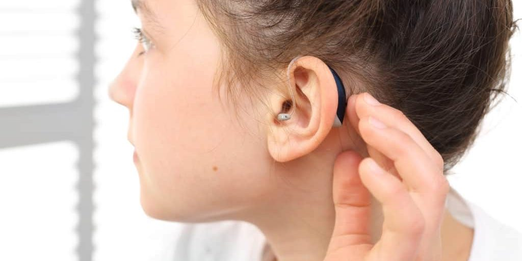 Girl with hearings aids