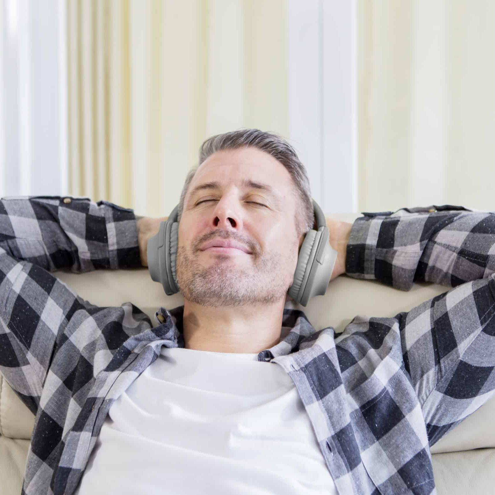 Young man enjoying music with headphones